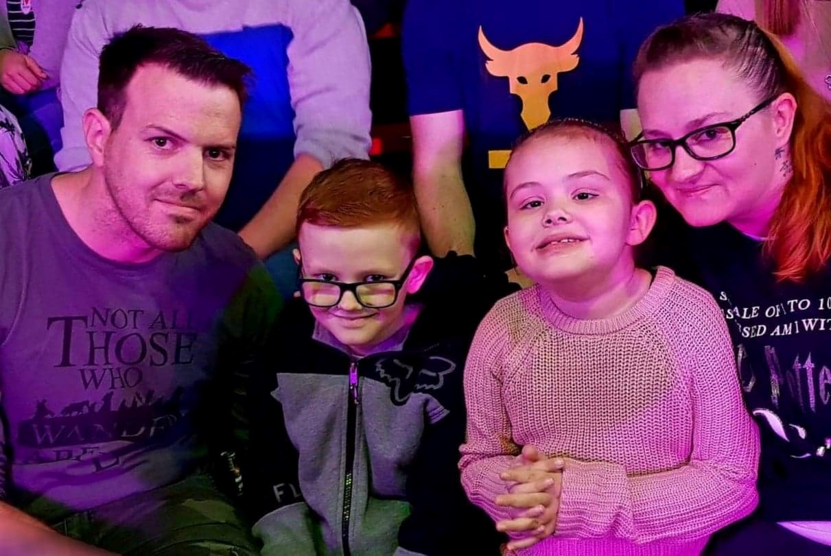An image of Skye and her family sitting together enjoying the Circus Starr show.